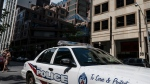 A police cruiser is parked in front of the TorontoPolice Services headquarters, in Toronto, on Friday, August 9, 2019. THE CANADIAN PRESS/Christopher Katsarov