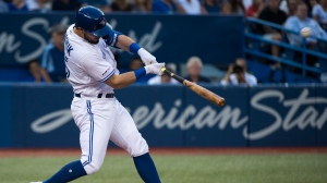 Toronto Blue Jays designated hitter Randal Grichuk hits a solo home run against the Texas Rangers during second inning American League MLB baseball action in Toronto on Tuesday, August 13, 2019. THE CANADIAN PRESS/Nathan Denette