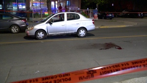 Police blocked off Beaubien St. near 40th Ave. for several hours while they conducted tests on this car after the driver hit a pedestrian (CTV Montreal/Cosmo Santamaria)