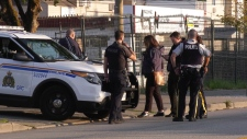 Police and the IIO were seen outside a shelter after reports of a shooting Wednesday morning.
