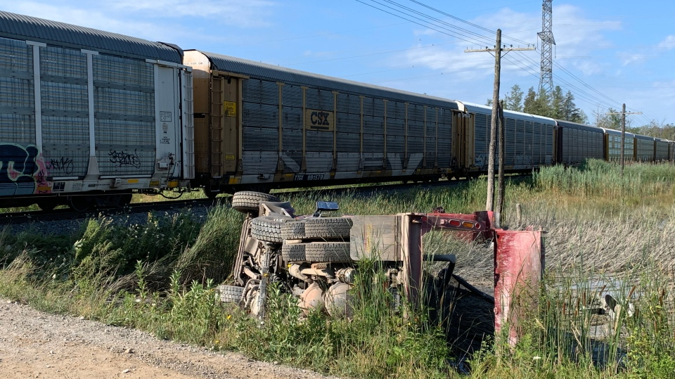 A dump truck seriously damaged after a collision with a train. (Jeff Pickel / CTV Kitchener)