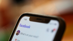 In this Sunday, Aug. 11, 2019, photo an iPhone displays a Facebook page in New Orleans. (AP Photo/Jenny Kane)