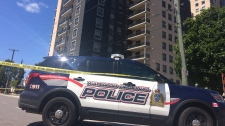 A police cruiser in front of a building