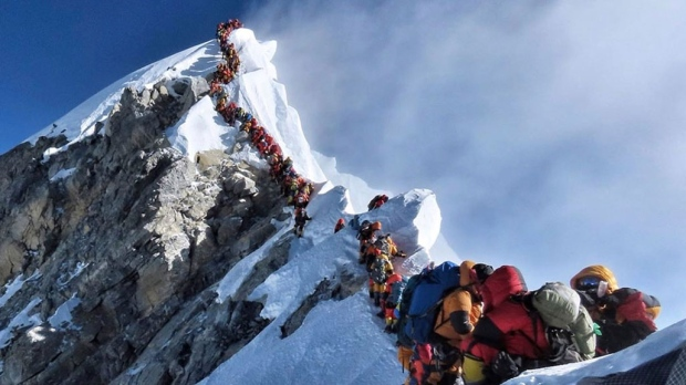 In this photo made on May 22, 2019, a long queue of mountain climbers line a path on Mount Everest. (Nirmal Purja/@Nimsdai Project Possible via AP)