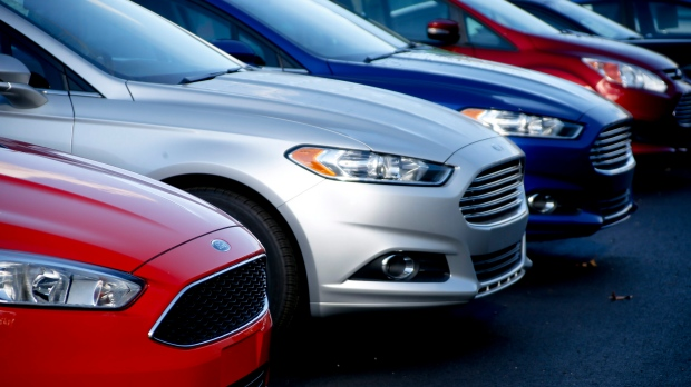 In this Nov. 19, 2015, photo, a row of new Ford Fusions are for sale on the lot at Butler County Ford in Butler, Pa. (AP Photo/Keith Srakocic, File)