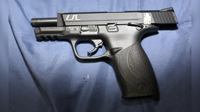 A handgun seized from a residence in Lakeshore, Ont. is seen in this image provided by Essex County OPP.