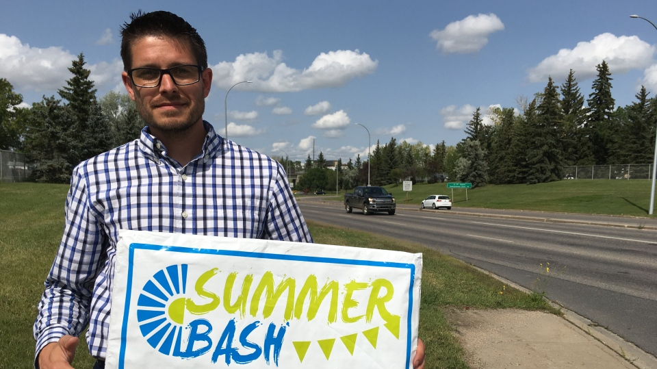 Photo caption: Adam Hicks stands with a lawn sign for the Summer Bash, the event he was advertising when his car was stolen Wednesday morning. (Cole Davenport/CTV Regina)