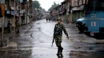 An Indian paramilitary soldier patrols during security lockdown in Srinagar, Indian controlled Kashmir, Wednesday, Aug. 14, 2019. India has maintained an unprecedented security lockdown to try to stave off a violent reaction to Kashmir's downgraded status. Protests and clashes have occurred daily, thought the curfew and communications blackout have meant the reaction is largely subdued. (AP / Dar Yasin)