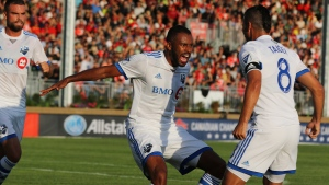Montreal Impact's Anthony Jackson-Hamel, centre, celebrates his goal against Cavalry FC with teammate Saphir Taider (8) during first half Canadian Championship semifinal soccer action in Calgary on Wednesday Aug. 14, 2019. THE CANADIAN PRESS/Dave Chidley