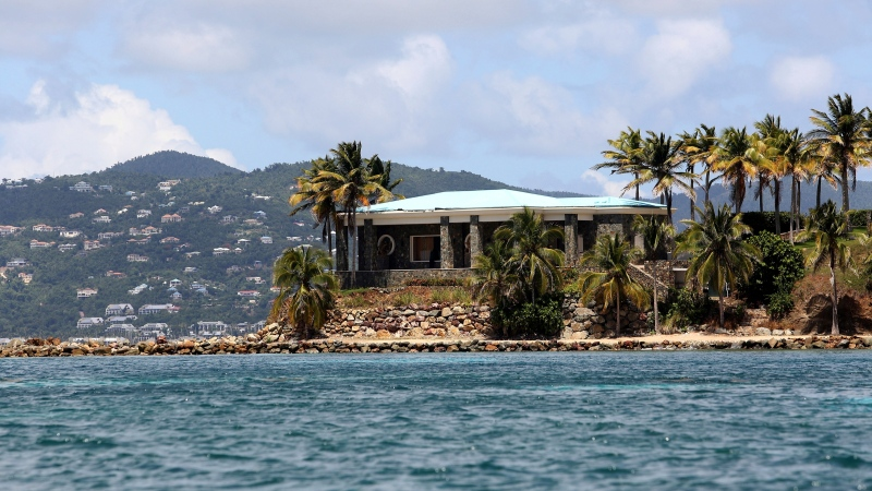 A view of Jeffrey Epstein's stone mansion on Little St. James Island, a property owned by Jeffrey Epstein, is backdropped by St. John Island, Wednesday, August 14, 2019. (AP Photo/Gabriel Lopez Albarran)
