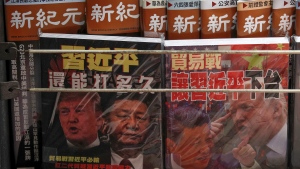 In this July 4, 2019, photo, Chinese magazines with front covers featuring Chinese President Xi Jinping and U.S. President Donald Trump on trade war is placed on sale at a roadside bookstand in Hong Kong. (AP Photo/Andy Wong)
