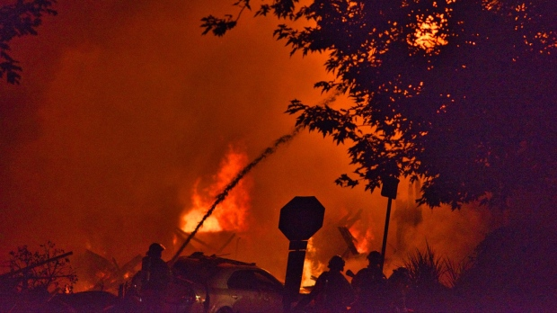 A firefighter battles a massive blaze in Old East Village in London, Ont. following an explosion on Wednesday, Aug. 14, 2019. (Source: Joseph O'Neil)