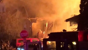 Vehicle slammed into house, triggered explosion