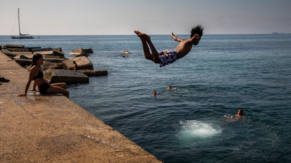 boy jumps into the water