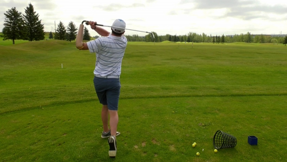 Kristian Hammerback, president of the Canadian Amputee Golf Association, practices his swing at River's Edge Golf Course