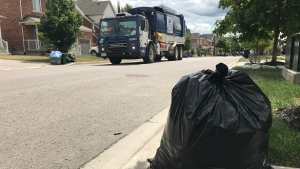 A waste management crew does curbside collection in Barrie on Thurs., Aug. 15, 2019. (CTV News/Krista Sharpe)