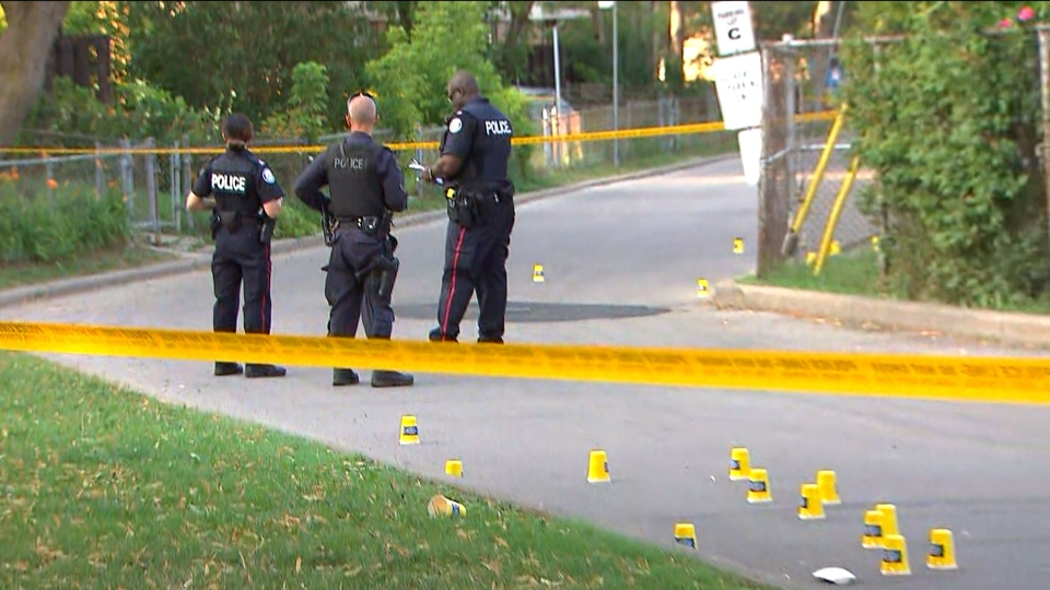 Police officers are seen investigating a shooting. (CTV News Toronto)
