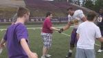 Laurier football team pauses for special event