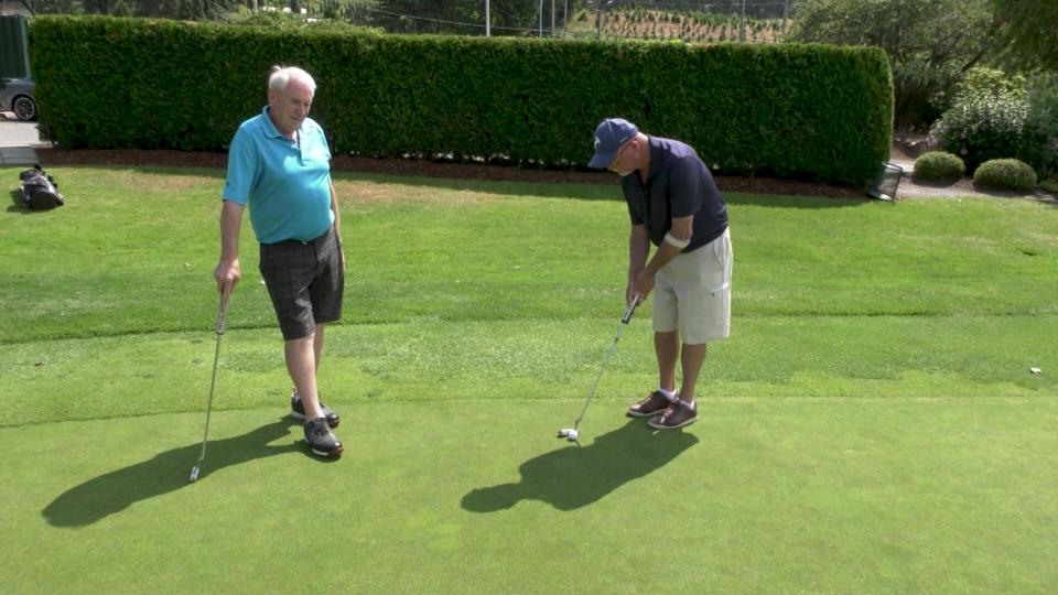Dave Garrett and Brian Casey golfing