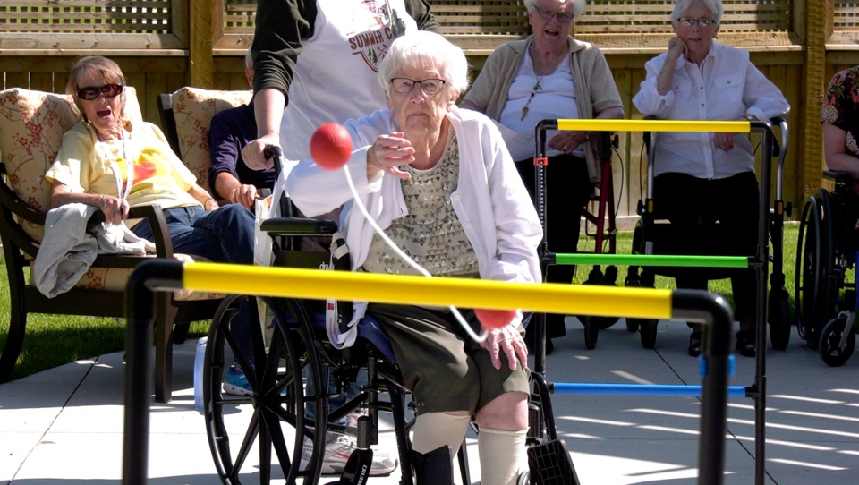 A competitor concentrates on her ladder ball throw during the 2019 All Seniors Care summer camp in northwest Calgary