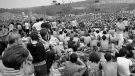 FILE - This Aug. 14, 1969 file photo shows a portion of the 400,000 concert goers who attended the Woodstock Music and Arts Festival held on a 600-acre pasture near Bethel, N.Y. It was great spot for peaceful vibes, but miserable for handling the hordes coming in by car. Fifty years later, memories of the anarchic weekend of Aug. 15-18, 1969, remains sharp among people who were in the crowd and on the stage for the historic festival. (AP Photo/File)