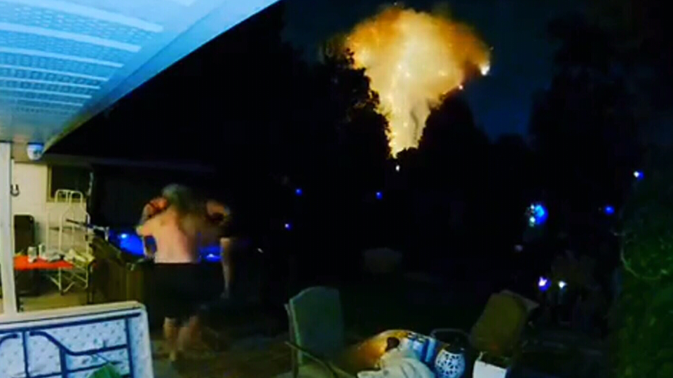 Security video captured the moment a London, Ont. house explosion startled a group of people enjoying a late night dip in a hot tub Wednesday night. (Nikki Best/Facebook)