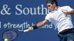 Roger Federer, of Switzerland, returns to Andrey Rublev, of Russa, during the quarterfinals of the Western & Southern Open tennis tournament, Thursday, Aug. 15, 2019, in Mason, Ohio. (AP Photo/John Minchillo)