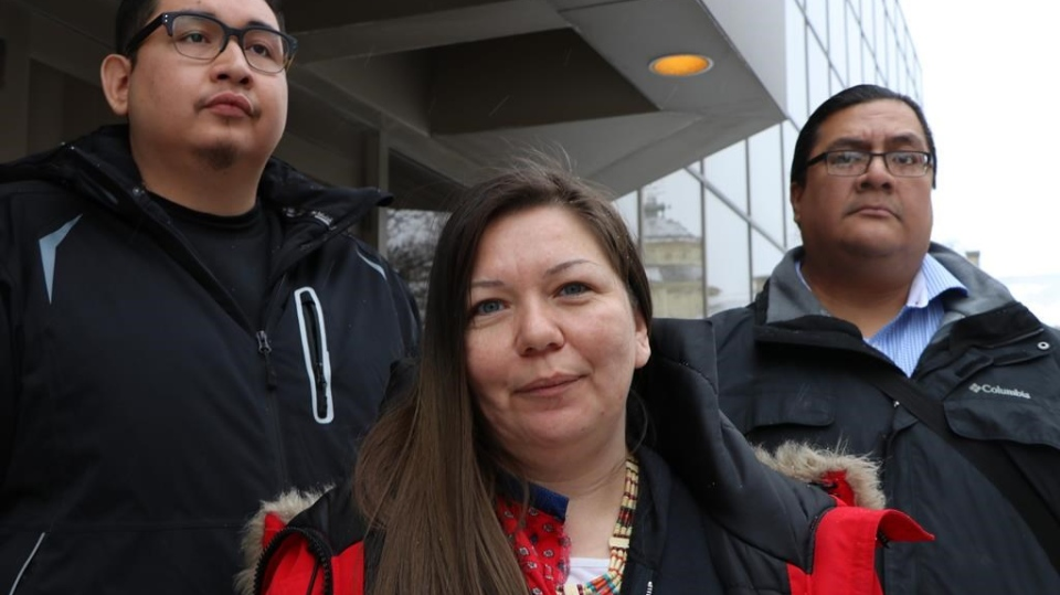 Melissa Stevenson, centre, of the Bear Clan Patrol stands outside the Winnipeg courthouse after Christopher Brass was sentenced to 15 years for manslaughter in the shooting death of Stevenson's best friend, 29-year-old Jeanenne Fontaine, on Wednesday, Jan. 23, 2019. THE CANADIAN PRESS/Kelly Malone