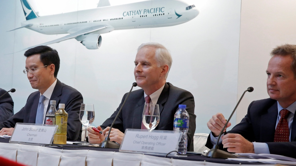 FILE - In this March 15, 2017, file photo, from right, Cathay Pacific Chief Operating Officer Rupert Hogg, Chairman John Slosar and Chief Executive Ivan Chu attend a news conference as they announce the company result in Hong Kong. (AP Photo/Kin Cheung, File)