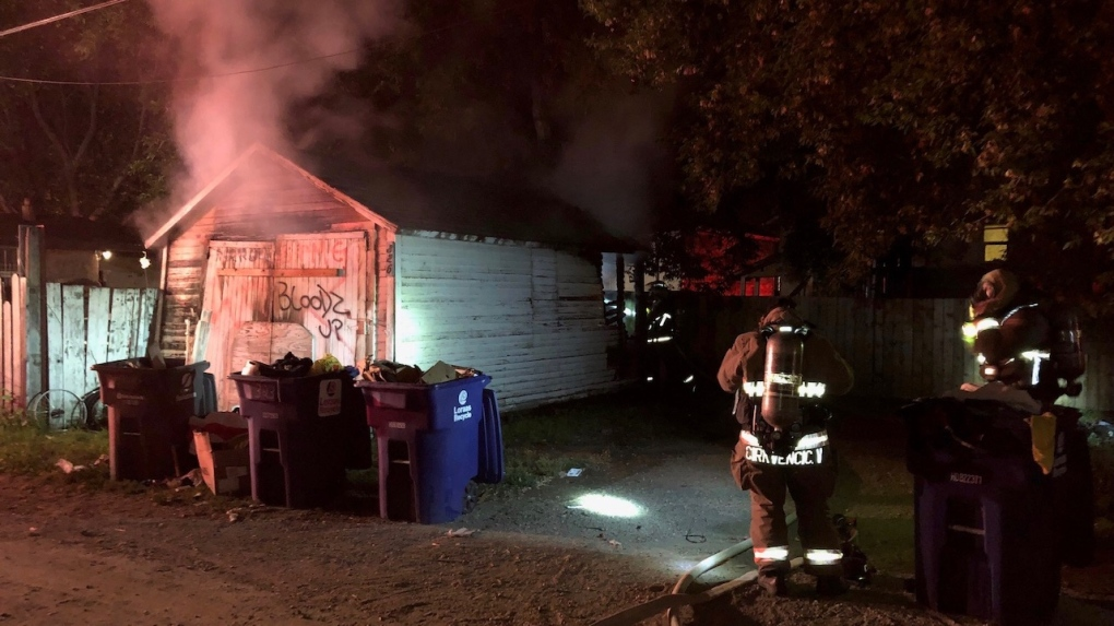 Arson suspected in overnight garage fire