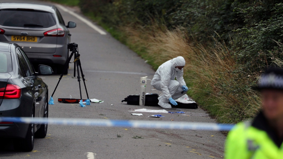 A police investigator at the scene of an incident