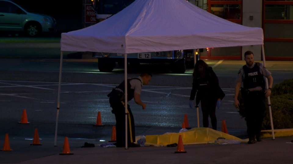 A body was covered by a tarp at the Semiahmoo Shopping Centre Friday morning.
