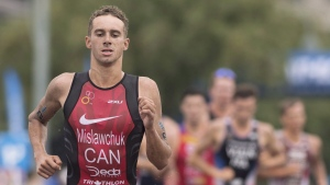 Tyler Mislawchuk of Canada competes during the ITU World Triathlon Series race in Montreal, Sunday, August 26, 2018. (THE CANADIAN PRESS/Graham Hughes)