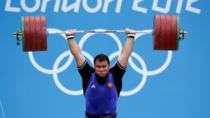 In this file photo dated Tuesday, Aug. 7, 2012, Ruslan Albegov of Russia competes during men's over 105-kg weightlifting competition at the 2012 Summer Olympics, in London. (AP Photo/Hassan Ammar, FILE)