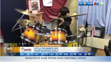 Little girl drums like a pro