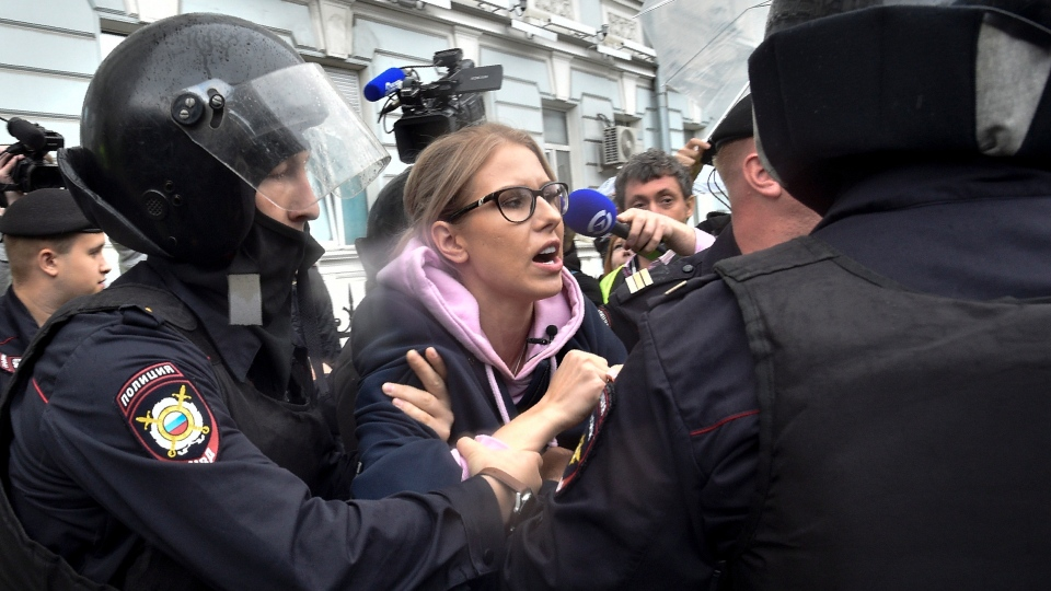 In this file photo taken on Saturday, Aug. 3, 2019, Police officers detain an opposition candidate and lawyer at the Foundation for Fighting Corruption Lyubov Sobol in the center of Moscow, Russia. (AP Photo/Dmitry Serebryakov, File)