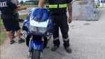Police impound a blue motorcycle after the driver is charged with stunt driving in Innisfil on Fri., Aug. 16, 2019 (South Simcoe Police)