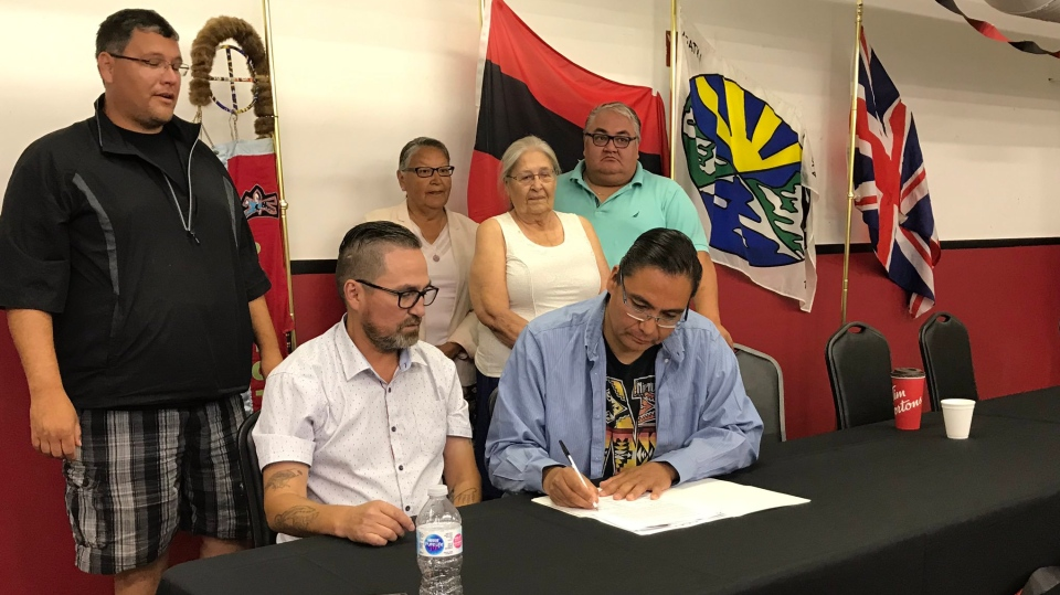 Representatives from Saskatchewan and Alberta First Nations sign an agreement to improve the quality of water. (Stefanie Davis/CTV Regina)