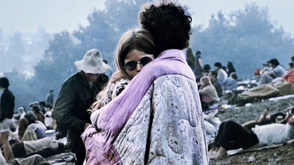 A Vancouver Island woman is disputing an American couple's claim they are the ones in an iconic photo from the music festival Woodstock, which celebrates its 50th anniversary this week.