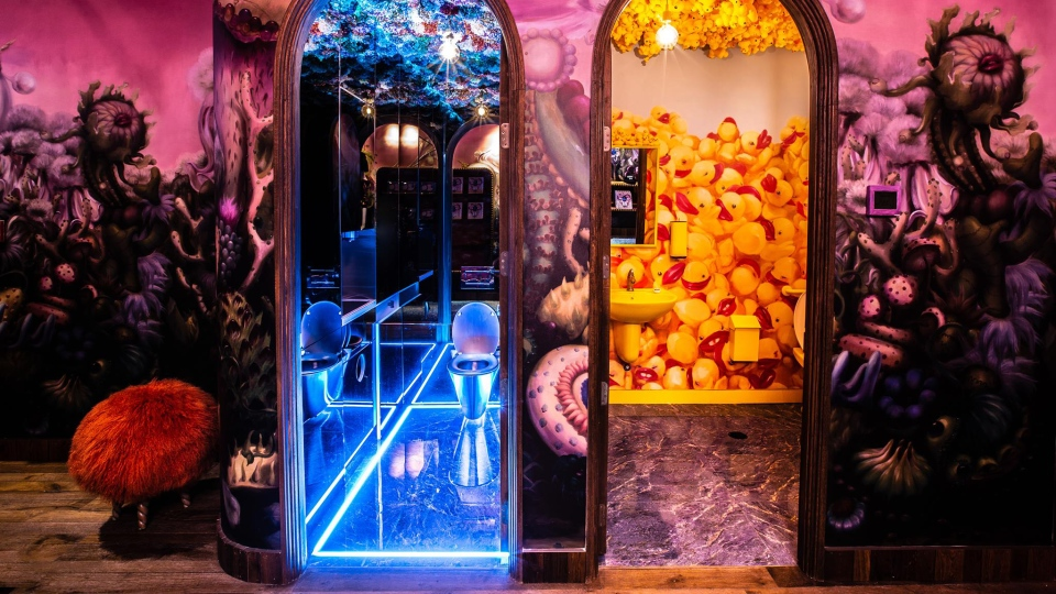 These unique bathrooms at Laurence and Chico Cafe in Vancouver are up for the top prize -- one features a rubber ducky theme, while the other has glowing blue lights and paper flowers. (Laurence and Chico Cafe / Facebook)
