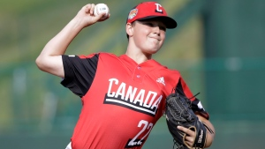 British Columbia's Matt Shanley (22) delivers a pitch against Mexico in a baseball game at the Little League World Series in South Williamsport, Pa., Friday, Aug. 16, 2019. (AP Photo/Tom E. Puskar)