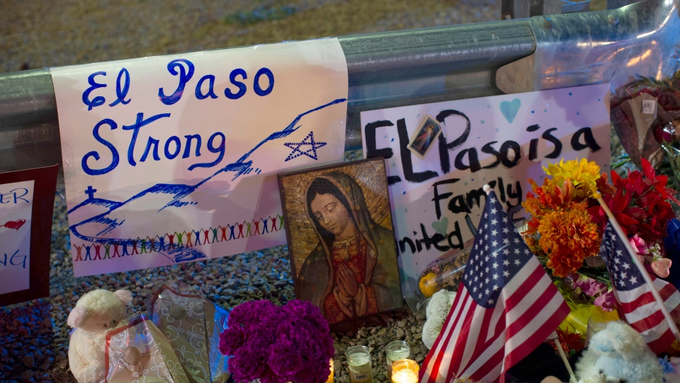 In this Aug. 4, 2019 file photo, a Virgin Mary painting, flags and flowers adorn a makeshift memorial for the victims of the mass shooting at a Walmart in El Paso, Texas. (AP Photo/Andres Leighton, File)
