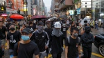Pro-democracy protesters walk in a main street in Hong Kong Saturday, Aug. 17, 2019. (AP Photo/Kin Cheung)