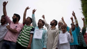 Kashmiri Muslims shout pro-freedom slogans during a demonstration after Friday prayers amid curfew like restrictions in Srinagar, India, Friday, Aug. 16, 2019. (AP Photo/Dar Yasin)