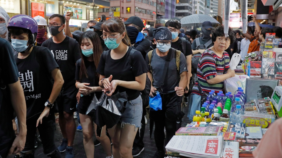 Protesters march during the anti-extradition bill