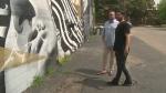 Business owner David Burman and artist David Derkatz look at vandalism on their art on Saturday, Aug. 17, 2019.