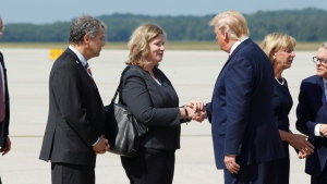 U.S. President Donald Trump greets Dayton Mayor Nan Whaley at Wright Patterson Air Force Base, Wednesday, Aug. 7, 2019, in Dayton, Ohio. (Ty Greenlees/Dayton Daily News via AP, Pool)