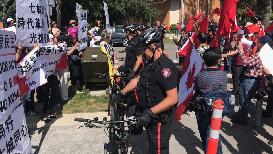 The Calgary Police Service was called in to monitor a protest and counter-protest about the situation in Hong Kong on Saturday.