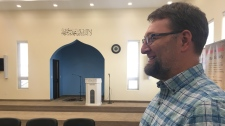 "Andre Boutin-Maloney looks on at a ""Meet Your Muslim Neighbours"" event where he looked to learn more about Islamic culture. (Cole Davenport/CTV News)"