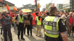 Vancouver police officers were on hand to maintain the peace at a dueling protest.
